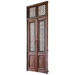 Monumental French Doors and Transom with Iron Grills