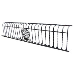 1880s Wrought Iron Bombay Balcony with Turns and Curls and a Central Medalion