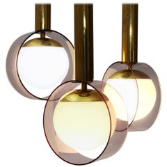 Italian Three Pendants in Brass and Opaline Glass Lamps by Stilux, 1960s