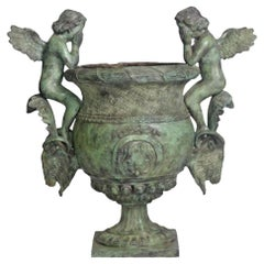 Classical Style Cast Bronze Urn with Two Cupids and Rams' Heads, Verde Patina