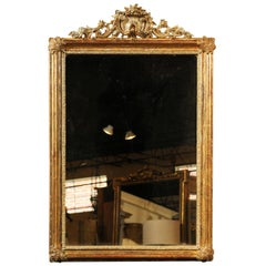 French Giltwood Mirror with Shell-Carved Crest and Floral Motifs, circa 1880