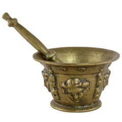 Early 20th Century French Bronze Mortar and Pestle with Masks Motif