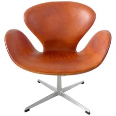Early Edition Arne Jacobsen Swan Chair in Original Cognac Leather Denmark, 1964