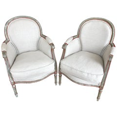 Wonderful Smallish Pair of French Painted and Upholstered Bergere Club Chairs
