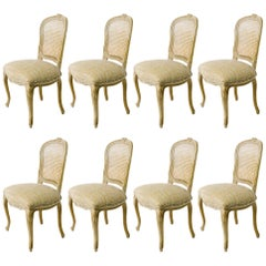 Eight French Caned Back Carved Dining Chairs from the 1930s