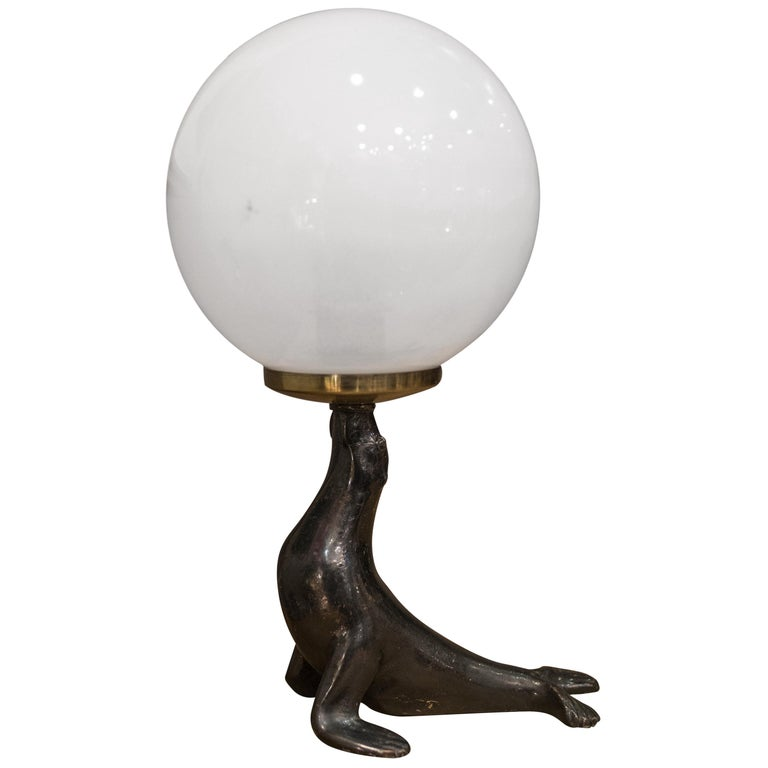 Art Deco Bronze Seal Figure and Glass Globe Table Lamp  For Sale