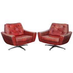 Pair of Swedish Mid-Century Modern Red Leather Swivel Lounge Chairs