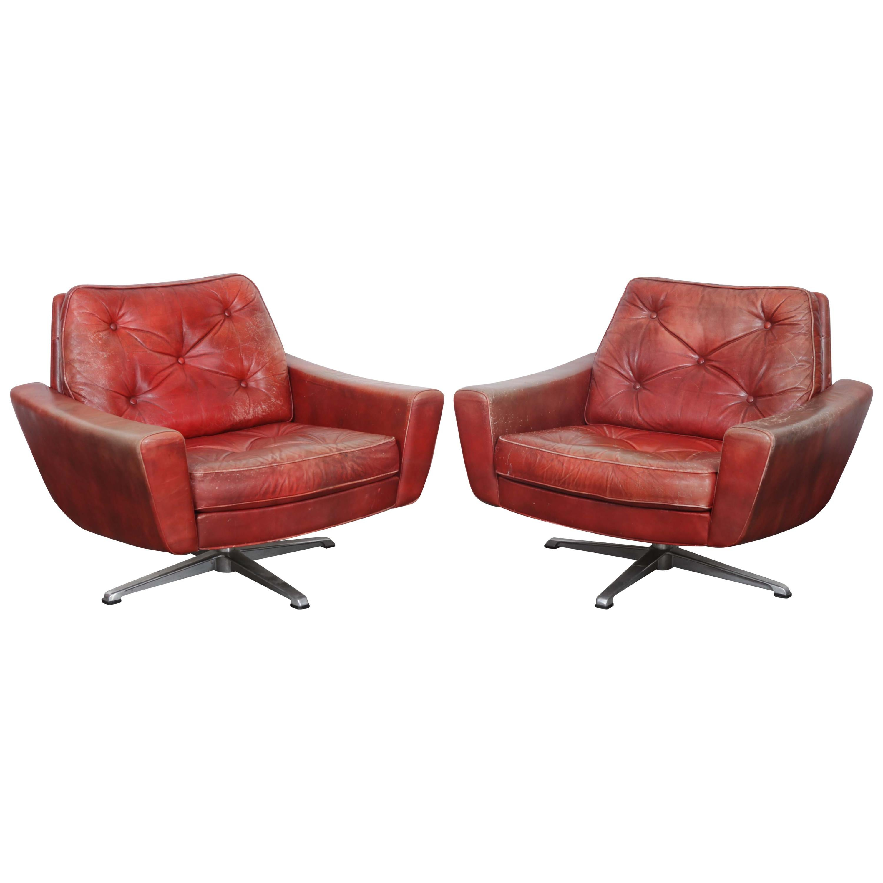 Pair Of Swedish Mid Century Modern Red Leather Swivel Lounge Chairs For Sale