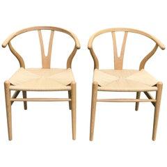 Pair of Hans Wegner for Carl Hansen Wishbone Chairs in Oak with Handwoven Seat