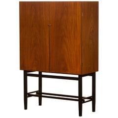1968, Mahogany and Brass Dry Bar Cabinet High Black Skinny Legs by Förenade