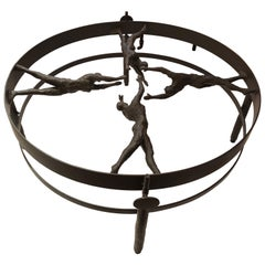 Striking Figural Iron and Glass Giacometti Style Coffee Table