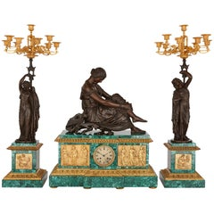 Neoclassical Style Patinated Bronze, Ormolu and Malachite Clock Set