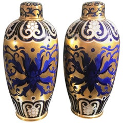 Pair of English 19th Century Hand-Painted and Gilt Porcelain Urns