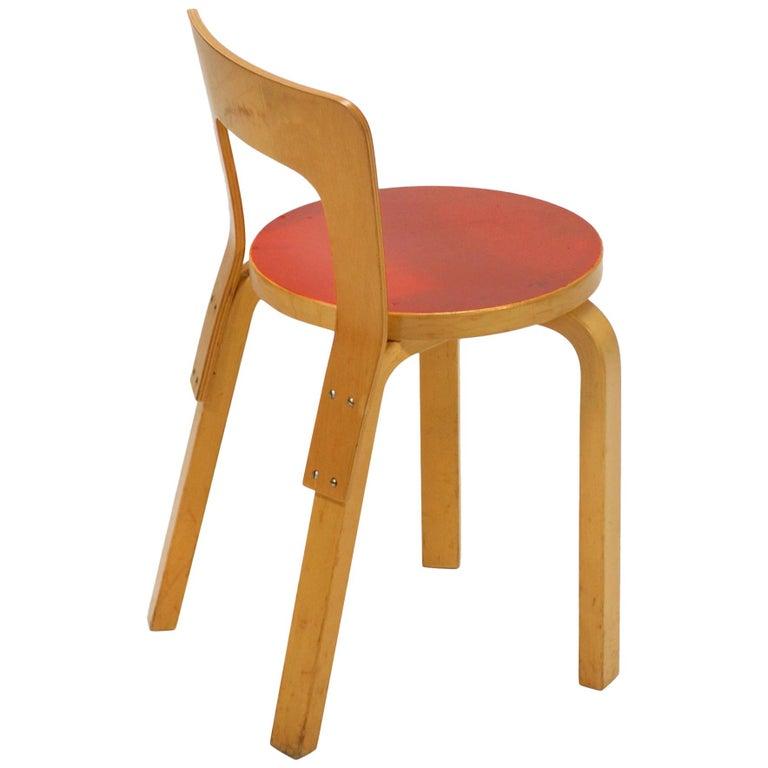 Alvar Aalto Model 65 Chair with Red Seat by Artek