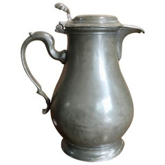 Continental Pewter Covered Jug, Baluster Shaped with Shell Thumb Piece