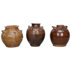 Three Martaban Stoneware Pots in Various Sizes and Designs