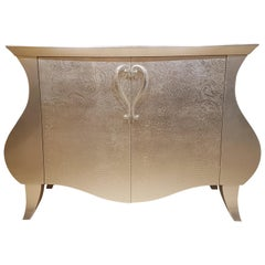 Curved Commode with a Floral Gold Leaf Finish