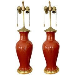 Pair of Vibrant Orange Porcelain Lamps on Water Gilt Bases
