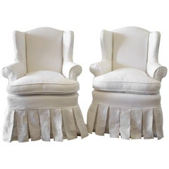 Pair of Slip Covered Linen Wing Chairs with Ruffle Skirt