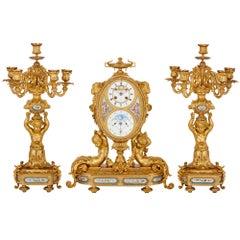 Antique French Gilt Bronze and Sèvres Style Porcelain Clock Set