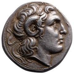 Ancient Greek Silver Tetradrachm Coin with the Portrait of Alexander the Great