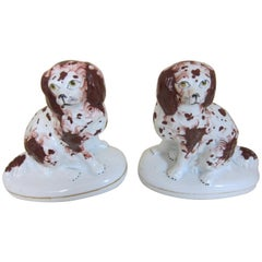 Pair of English Porcelain Figures of Spaniels Decorated in Brown