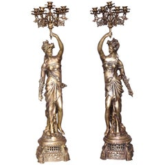 Pair of Hand Cast Bronze Continental Ladies Holding Five-Arm Candelabras