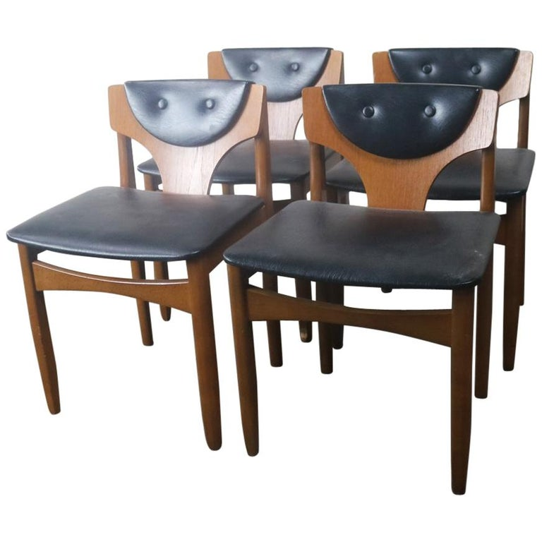 Set of Four 1970s Midcentury German Low Back Black Vinyl Dining Chairs