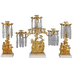Antique French Gilt Metal, Marble and Crystal Three-Piece Figural Girandole Set