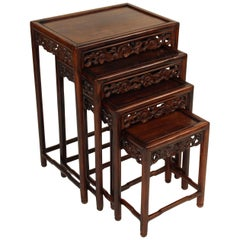 Nest of Four Chinese Teak Wood Tables