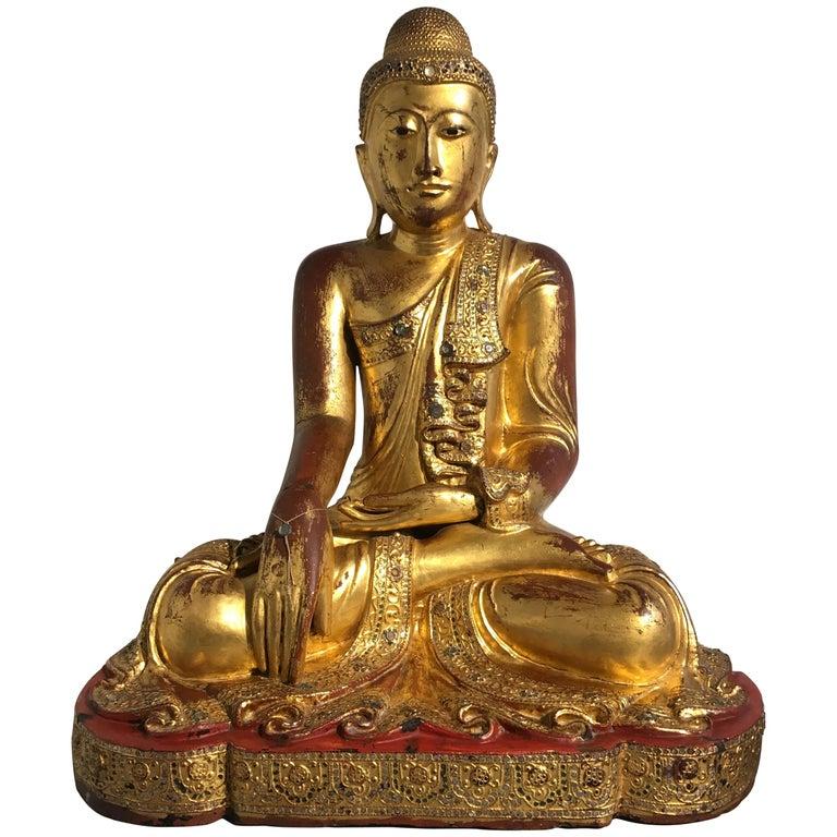 Large Burmese Mandalay Period Carved, Lacquered and Gilt Teak Buddha, circa 1900
