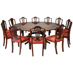 "20th Century Extending Circular ""Jupe"" Style Dining Table and 12 Chairs"