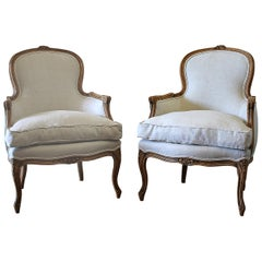 20th Century Pair of Carved & Upholstered Louis XV Style Bergère Chairs in Linen