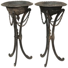 Pair of Black Iron Standing Urns or Planters