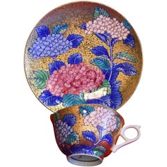 Japanese Gilded Hand-Painted Porcelain Cup and Saucer by Master Artist