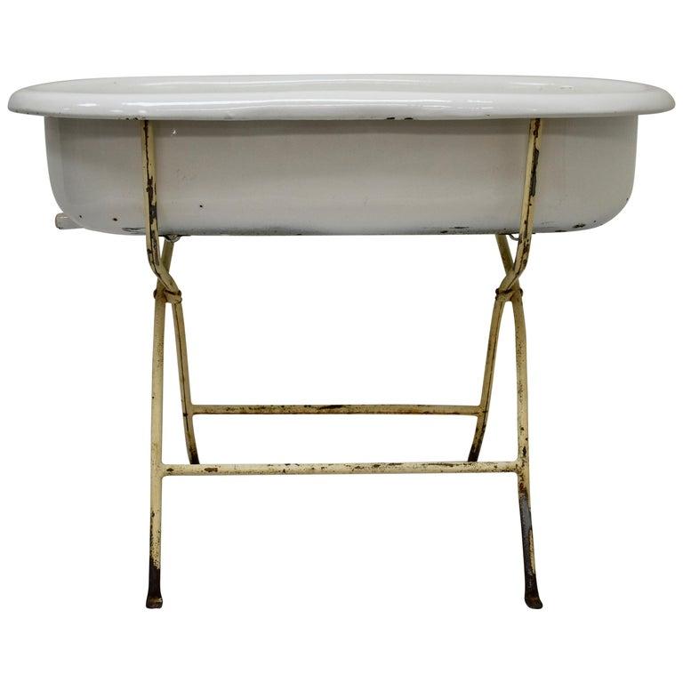 Vintage Porcelain Enamel Baby Bath on Folding Stand For Sale at 1stdibs