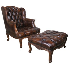 Pair of French Leather Tufted Armchairs with Matching Ottomans