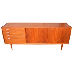 Teak Kai Kristiansen Credenza with Graduated Drawers and His Iconic Smile Pulls