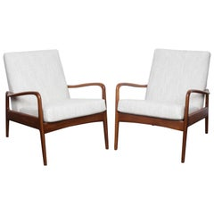 Pair of Solid Afromoisa Teak Lounge Chairs by Greaves and Thomas, England