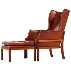Mogens Koch Wing-Back Lounge Chair with Stool by Cabinetmaker Rud Rasmussen