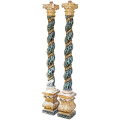 Pair of Baroque Style Spiral Carved Parcel Gilt and Faux Marble Columns