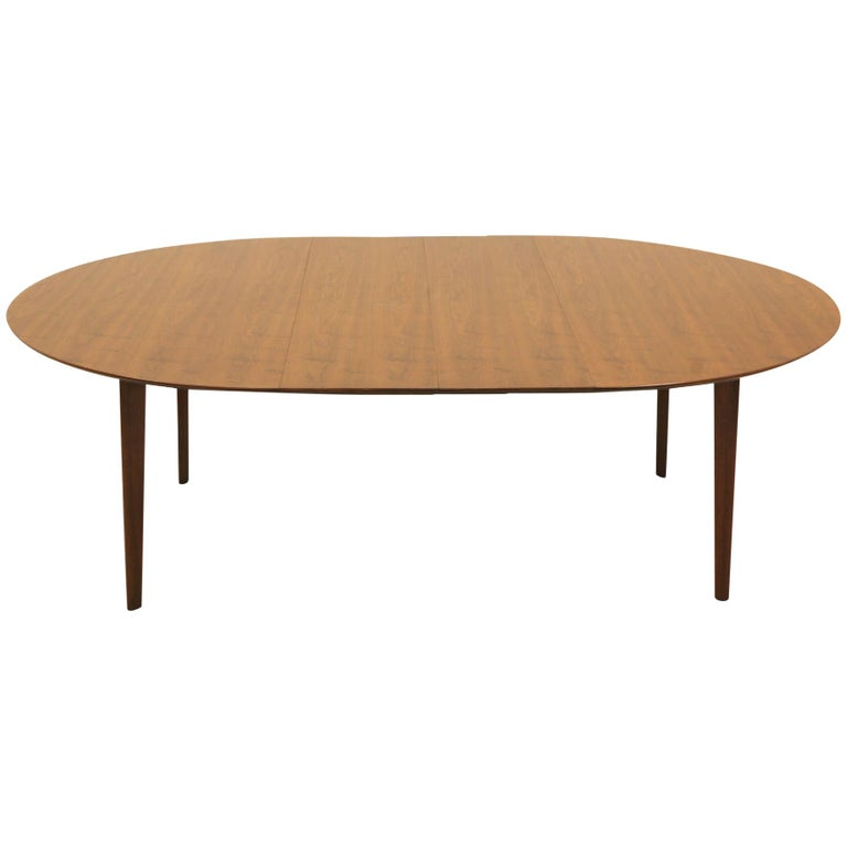 Oval Walnut Dining Table, Expandable with Two Leaves by Edward Wormley