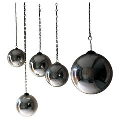 Group of Five Victorian Silver Mercury Glass Witches Balls, circa 1900