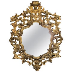 Exuberant Italian Revival Carved Giltwood Mirror