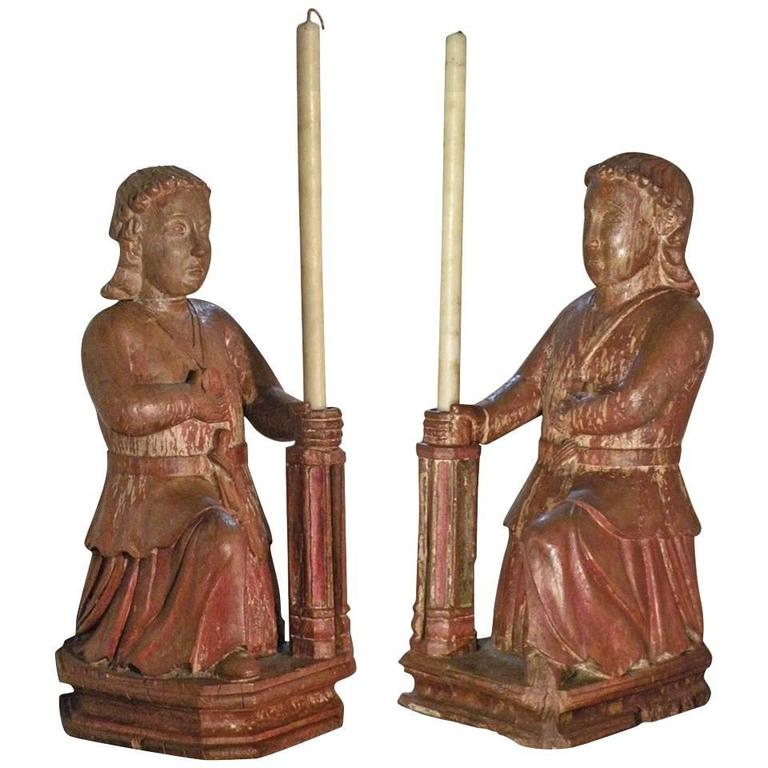 Large, Rare Pair of Colonial 17th century candle-holding Sculptures