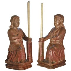 Pair of Colonial 17th century exotic wood candle-holding Sculptures