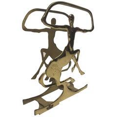 Gorgeous Stylized Deco Figural Brass Magazine Rack