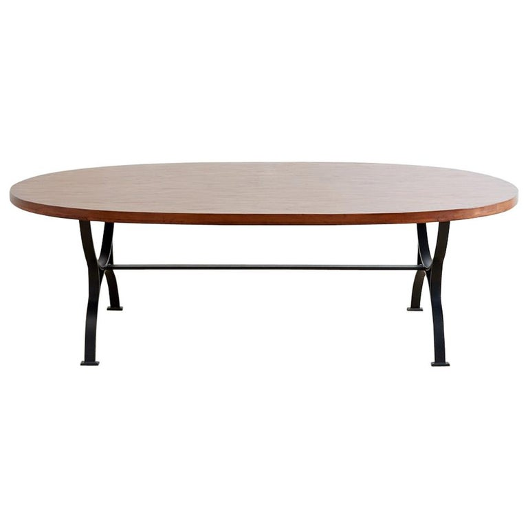 Oval Wooden Dining Table with Curule Iron Base