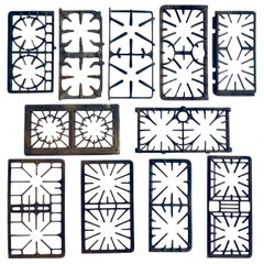 Collection of 11 Rare Antique Cast Iron Stove Grates, circa 1920-1950