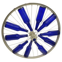 Modern Blue Bottles on a Bike Wheel Sculpture